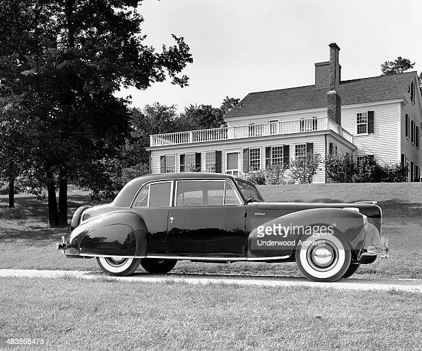 Lincoln Continental parked in front of a home Detroit Michigan 1941