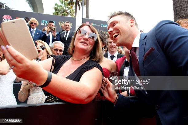 Lincoln Lewis takes photos with fans at the 2018 AACTA Awards Presented by Foxtel at The Star on December 5, 2018 in Sydney, Australia.