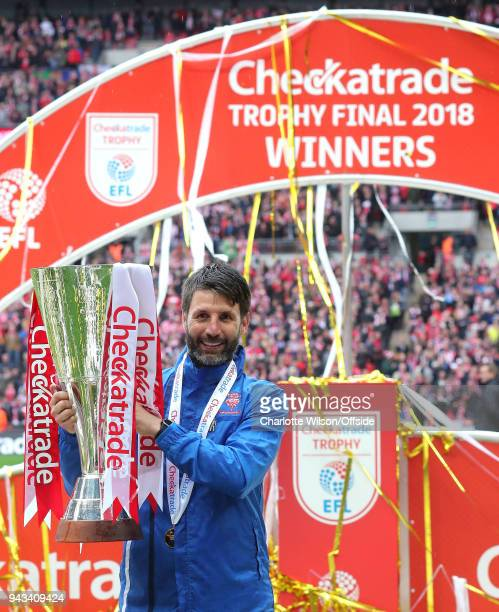 Lincoln manager Danny Cowley poses with the trophy during the Checkatrade Trophy Final between Lincoln City and Shrewsbury Town at Wembley Stadium on...