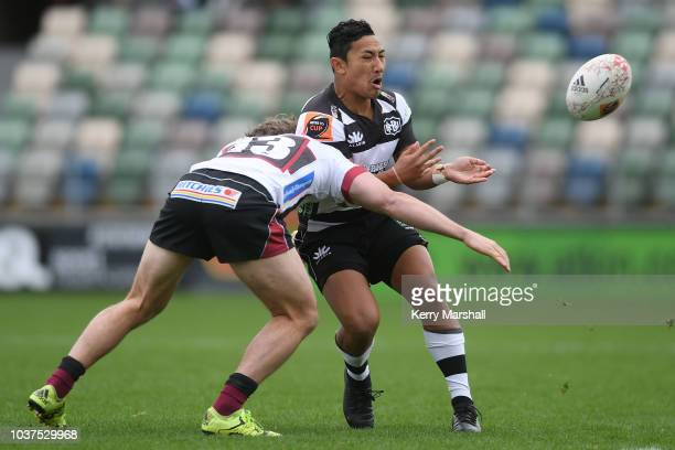 Sione Teu of North Harbour is tackled by Marino MikaeleTu'u of Hawke's Bay during the round six Mitre 10 Cup match between Hawke's Bay and North...