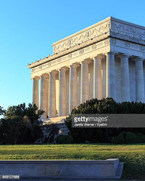 lincoln memorial by trees against clear sky - lincoln memorial stock pictures, royalty-free photos & images
