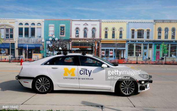 A Lincoln MKZ equipped with augmented Reality Technology maneuvers at the Mcity Test Facility on September 12 2017 in Ann Arbor Michigan The facility...