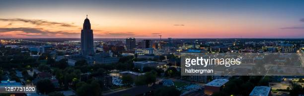 lincoln, nebraska at twilight - aerial panorama - lincoln nebraska stock pictures, royalty-free photos & images