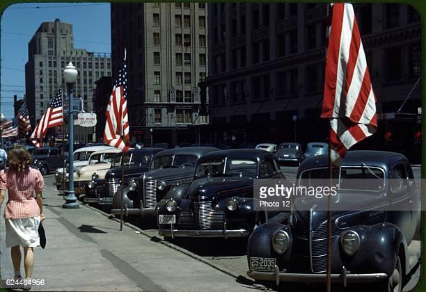 Lincoln Nebraska USA Street scene with cars and American flags during world War II 1942