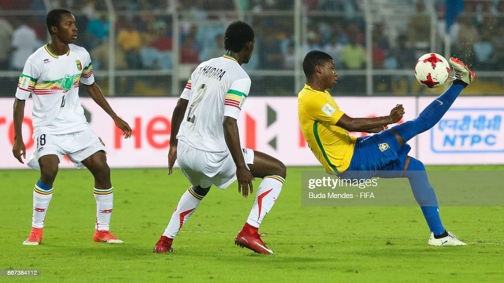 Lincoln of Brazil battles for the ball with Ibrahim Kane and