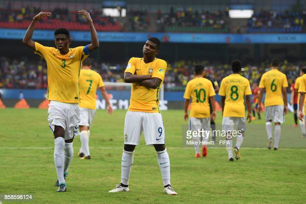 Lincoln of Brazil celebrates with captain Vitao after equalising during the FIFA U17 World Cup India 2017 group D match between Brazil and Spain at...