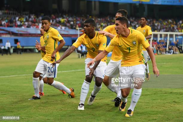Lincoln of Brazil celebrates with team mates after equalising during the FIFA U17 World Cup India 2017 group D match between Brazil and Spain at the...