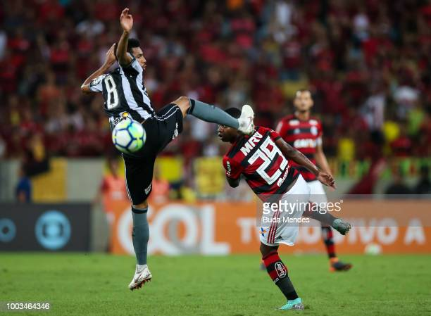 Lincoln of Flamengo struggles for the ball with Matheus Fernandes of Botafogo during a match between Flamengo and Botafogo as part of Brasileirao...