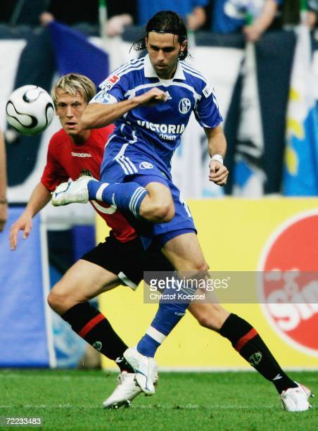 Lincoln of Schalke shields the ball from Frank Fahrenhorst of Hannover watches at him during the Bundesliga match between FC Schalke 04 and Hanover...
