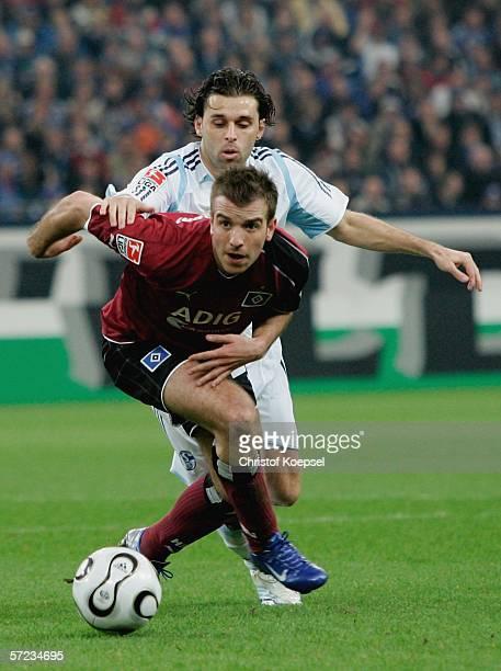 Lincoln of Schalke tackles Rafael van der Vaart of Hamburg during the Bundesliga match FC Schalke 04 and Hamburger SV at the Veltins Arena on April 2...