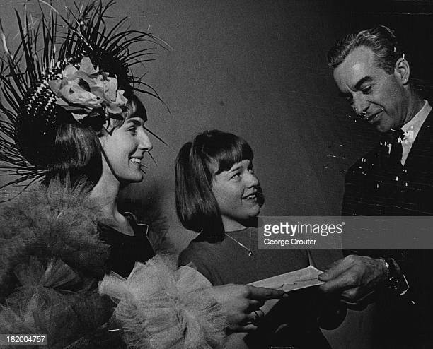 FEB 29 1965 MAR 3 1965 Lincoln Performer Wins Kim Kelly 16 of 3154 S Winona Court a senior at Lincoln High School is congratulated by Don Roberts of...
