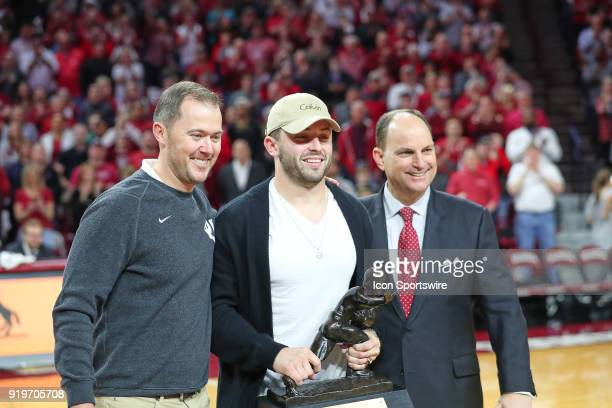 Lincoln Riley Baker Mayfield and Joe Castiglione being recognized during a college basketball game between the Oklahoma Sooners and the Texas...
