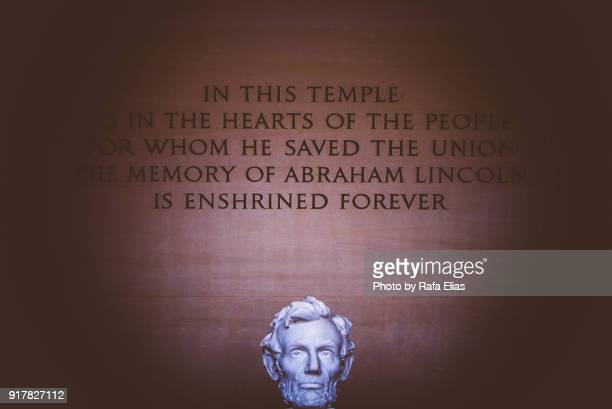 Lincoln statue head with legend in Lincoln Memorial (Washington DC, USA)