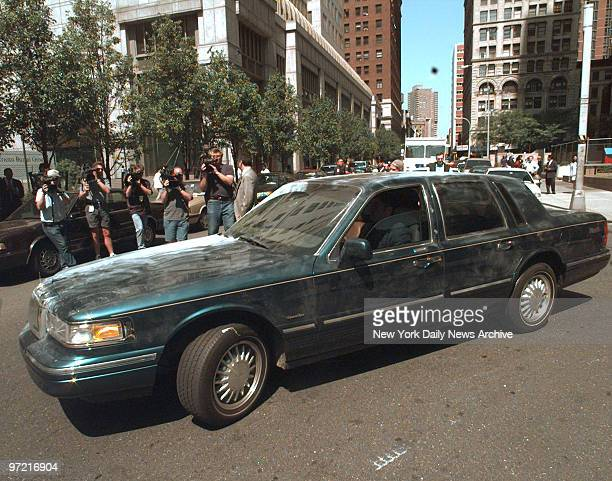 Lincoln Town Car belonging to motherandson con artist team Sante Kimes and Kenneth Kimes is driven out of FBI Headquarters covered with fingerprint...