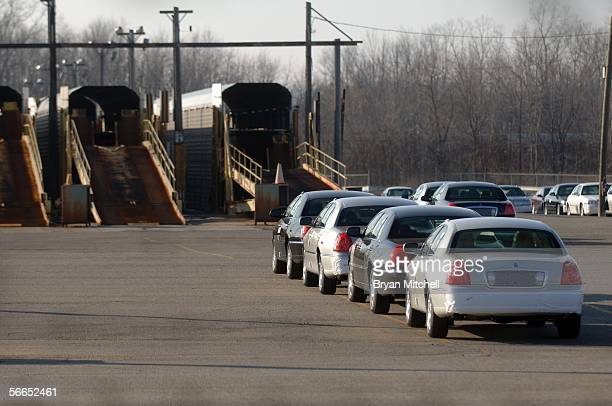 Lincoln Town Cars sit in the parking lot outside the Ford Motor Company Wixom plant January 23 2006 in Wixom Michigan Ford announced today that Wixom...