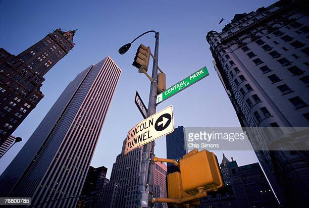 lincoln tunnel and central park signs - lincoln tunnel stock photos and pictures