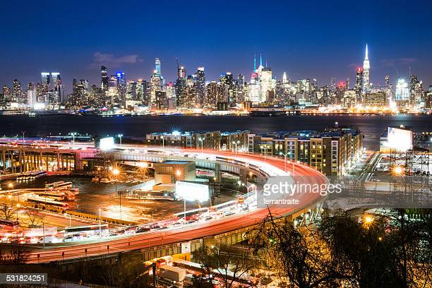 lincoln tunnel and new york city skyline at dusk - hudson river stock pictures, royalty-free photos & images
