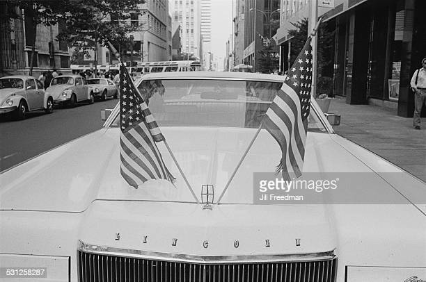 A Lincoln with two US flags on the hood New York City circa 1976