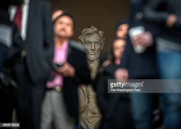 Lincoln's statue watches implacably as the Capitol Church leads the 36th annual sunrise Easter service at the Lincoln Memorial on April 2014 in...