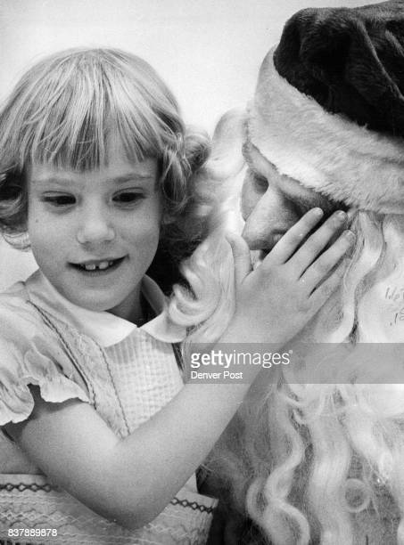 Linda Adams Peetz Colo What Santa's Really Like Lisa Gazarek of Colorado Springs left tugs beard of Santa and Linda Adams of Peetz Colo explores his...
