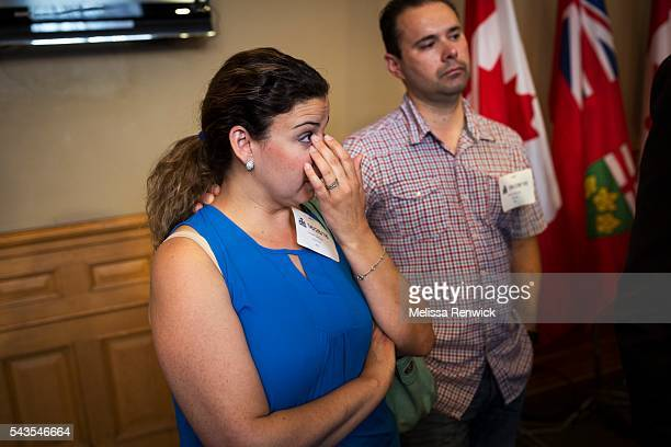 Linda and David Galvao gets emotional after the Minister of Children and Youth Services, Michael Coteau, addresses the media and parents at Queen's...