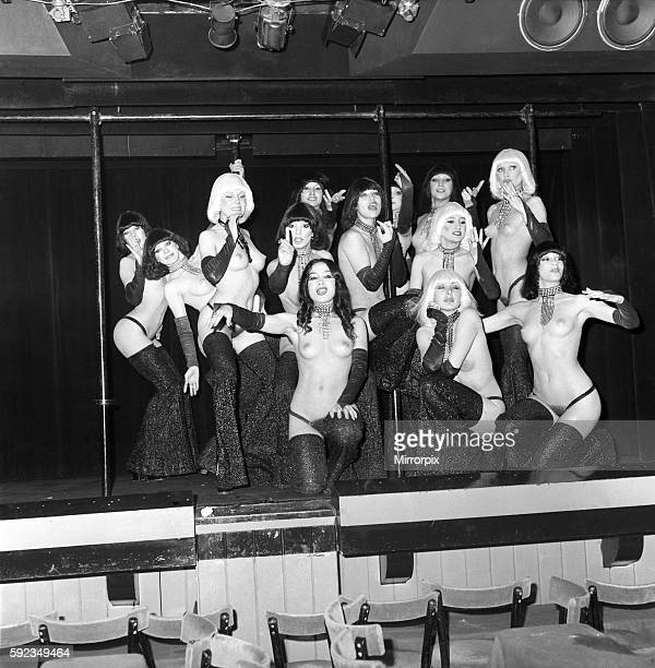 Linda at work with the girls of The Crazy Horse April 1975 752083004