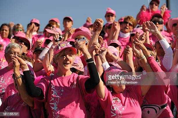 Linda Ballas a 17 year cancer survivor middle joins other survivors as they clasp hands and sing together The 18th annual Susan G Komen Denver Race...