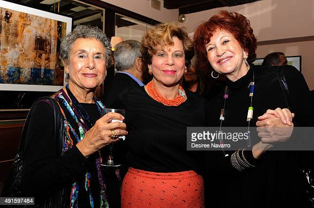 Linda Botton photographer Marge Neu and Carol Greenberg attend 'Color Thru My Lens' Opening Night Reception at Swifty's Restaurant on October 6 2015...