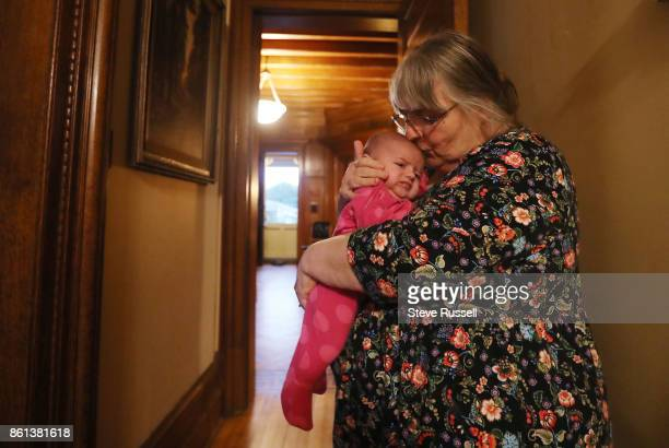 FALLS ON OCTOBER 14 Linda Boyle gives her granddaughter Grace a kiss Joshua Boyle's children in their grandparents home after arriving back in Canada...