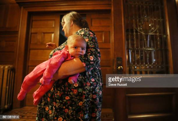 FALLS ON OCTOBER 14 Linda Boyle holds her granddaughter Grace Joshua Boyle's children in their grandparents home after arriving back in Canada after...