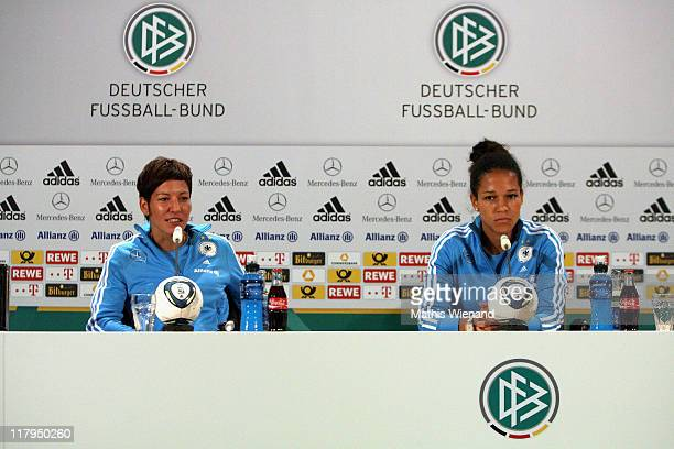 Linda Bresonik and Celia Okoyino da Mbabi attend the Germany Women national team press conference at Hilton Hotel on Juli 02 2011 in Duesseldorf...