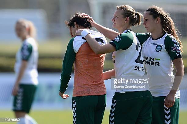 Linda Bresonik of Duisburg cries after missing a chance at goal during the Women's DFB Cup semi final match between 1. FFC Frankfurt and FCR Duisburg...