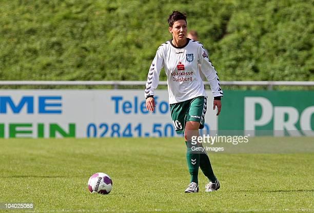 Linda Bresonik of Duisburg runs with the ball during the Women's bundesliga match between FCR Duisburg and FFC Frankfurt at the PCCStadium on...