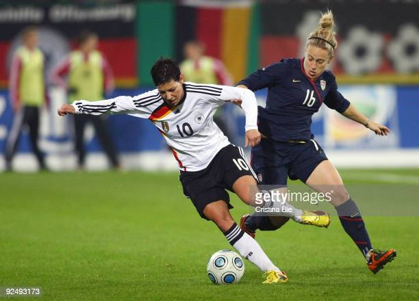 Linda Bresonik of Germany and Ella Masar of USA battle for the ball during the Women's International friendly match between Germany and USA at the...