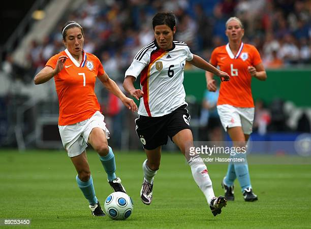 Linda Bresonik of Germany battles for the ball with Anouk Hoogendijk of the Netherlands and her team mate Annemieke Kissel during the Women's...