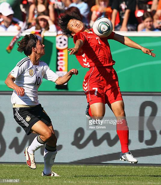 Linda Bresonik of Germany is challenged by Hyon Hi Yun of DPR Korea during the International friendly match between Germany and DPR Korea at Audi...