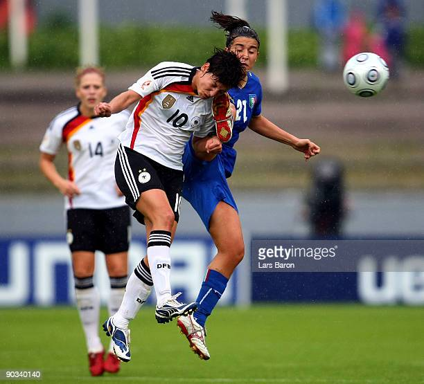 Linda Bresonik of Germany is challenged by Marta Carissimi of ITaly during the UEFA Women's Euro 2009 quarter final match between Germany and Italy...