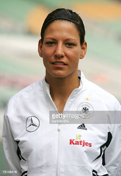 Linda Bresonik of Germany poses for pictures before their match against England at the Four Nations women's soccer match at Guangdong Olympic Stadium...
