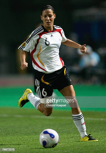 Linda Bresonik of Germany runs with the ball during the Quarter Final Womens World Cup 2007 match between Germany and Korea at Wuhan Sports Center...