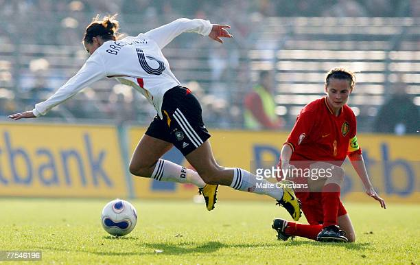 Linda Bresonik of Germany takes the ball past Femke Maes of Belgium during the UEFA Womens European Championship Qualifying match between Germany and...