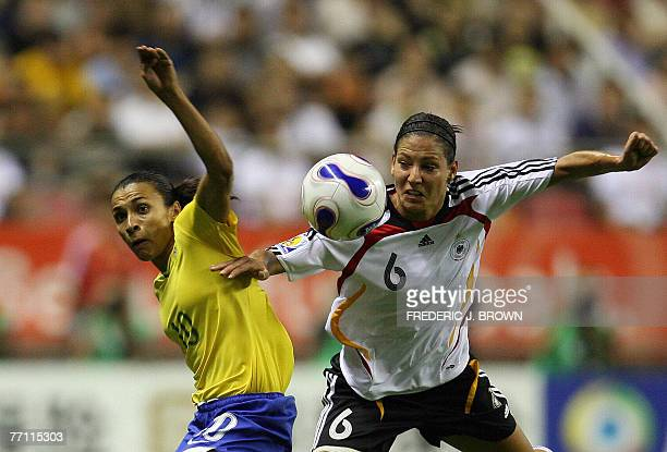 Linda Bresonik of Germany vies for the ball with Marta of Brazil during their final match in the FIFA Women's World Cup 2007 football tournament at...