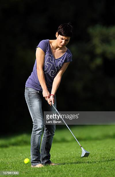 Linda Bresonik plays Swin Golf during a photocall at Swin Golf course Rutherhof on October 4, 2010 in Essen, Germany.
