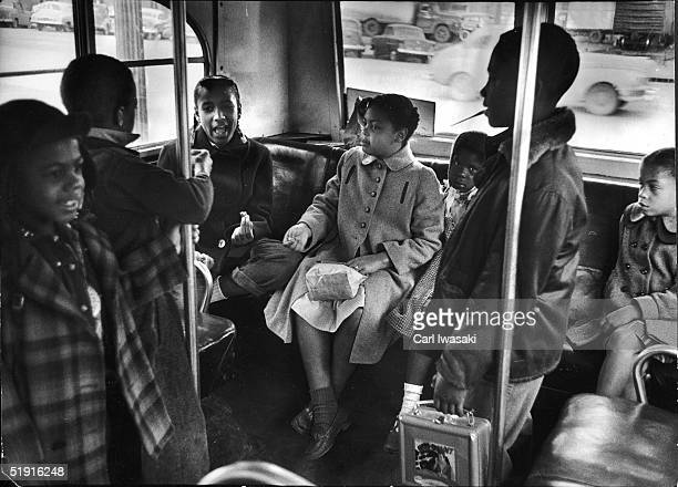 Linda Brown and her sister Terry Lynn sit on a bus as they ride to the racially segregated Monroe Elementary School Topeka Kansas March 1953 The...