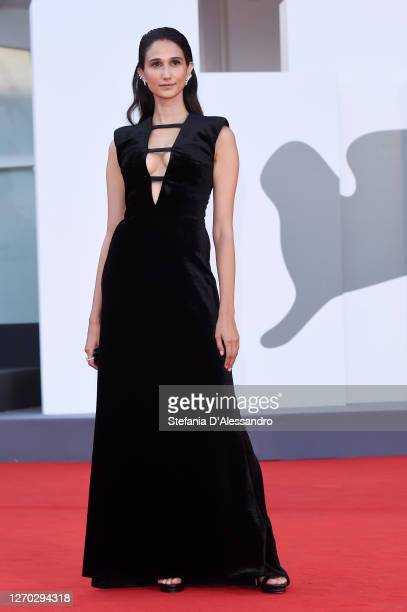 """Linda Caridi walks the red carpet ahead of the Opening Ceremony and the """"Lacci"""" red carpet during the 77th Venice Film Festival at on September 02,..."""