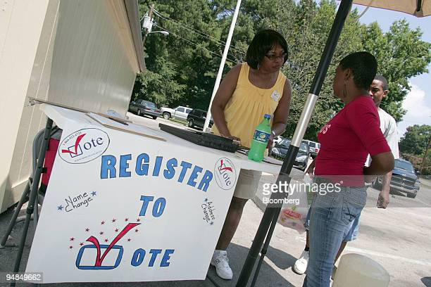 Linda Chavis left signs up Lucille Nicholson during a voter registration drive outside of Larry's Supermarket in Raleigh North Carolina US on Friday...