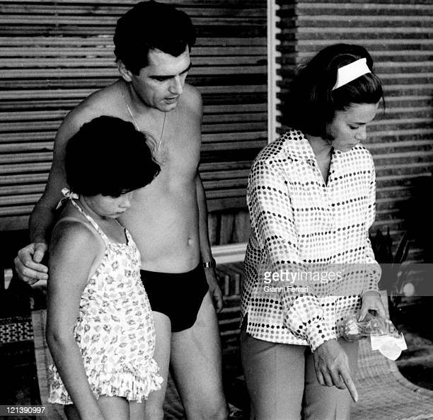 Linda Christian at her villa of 'La Moraleja' with her daughter Taryn and Edmund Purdom 12th August 1964 Madrid Spain