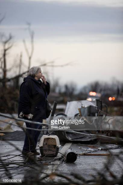 Linda Clemons surveys the damage to her home caused by high winds from one of several tornadoes that tore through the state overnight on March 3 2020...