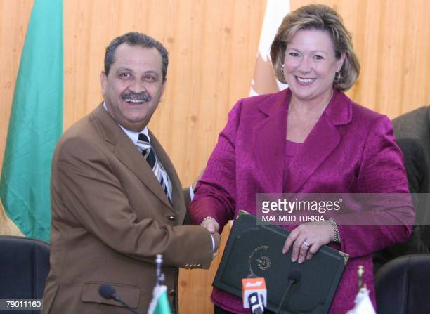 Linda Cook executive director of the AngloDutch energy giant Shell and Libyan Oil Minister Shukri Ghanem shake hands after signing 15 January 2008 in...