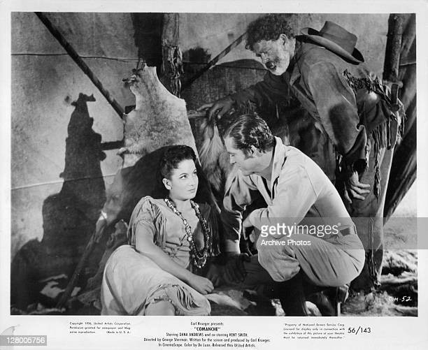 Linda Cristal and Dana Andrews gaze into one anothers eyes in a scene from the film 'Comanches' 1956