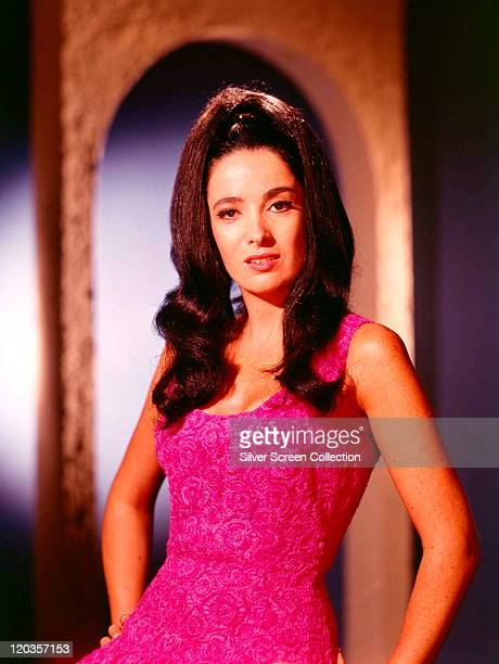 Linda Cristal Argentine actress wearing a pink sleeveless dress in a studio portrait circa 1970